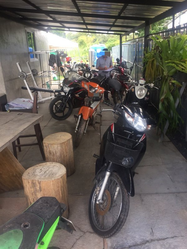 Police arrested 19 people involved in the illegal loan shark operation, and seized 17 motorbikes and a car. Photo: Phuket Provincial Police