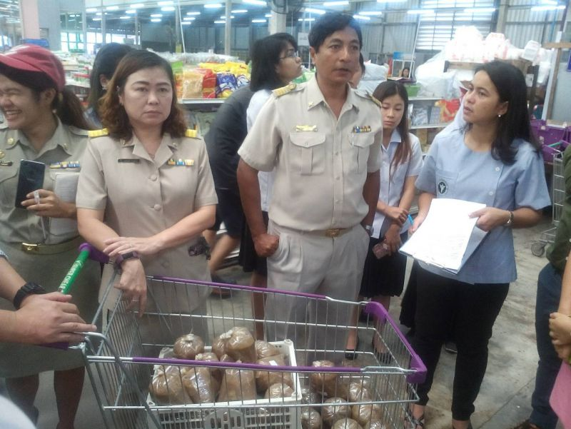 Head of the Phuket Consumer Protection Office, Somnuk Harem, and other officials carry out there inspection of the well-known local supermarket. Photo: Eakkapop Thongtub