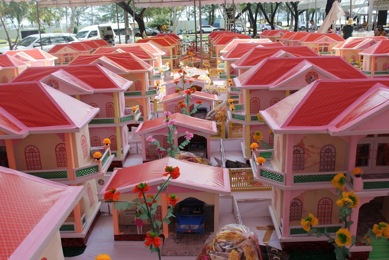 Paper houses for each spirit lost in the disaster were on display. The houses are to be burnt as a way of sending them to the heavens for the departed. Photo: PR Dept