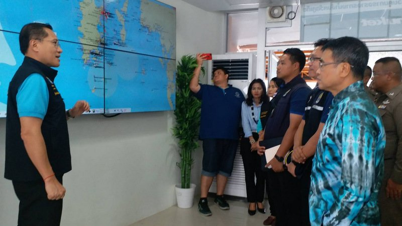 Tourism Minister Weerasak Kowsurat (left) is briefed at the Phuket Marine Office at Chalong Pier on Aug 20, nearly two weeks ago, but since then very little progress has been made in enforcing the new 'Phuket Marine Safety Plan'. Photo: PR Dept / file