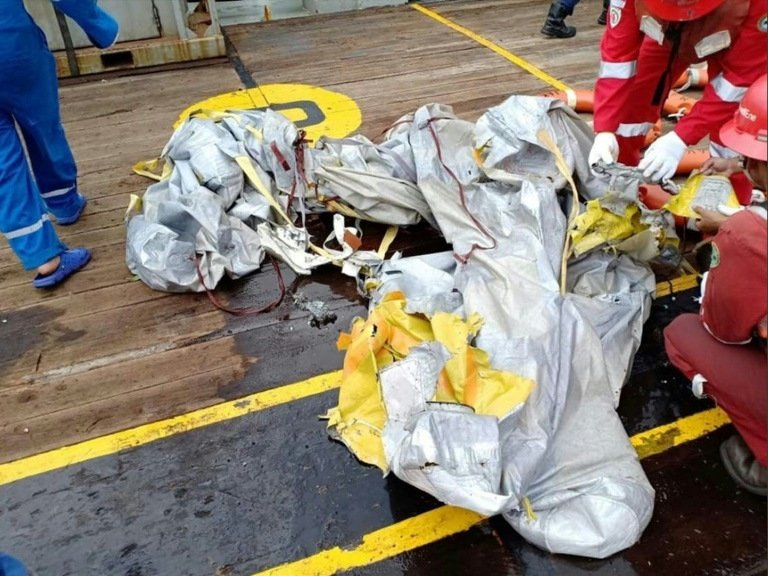 Debris apparently from the crashed jet was pulled out of the water. Photo: National Disaster Mitigation Agency handout via AFP
