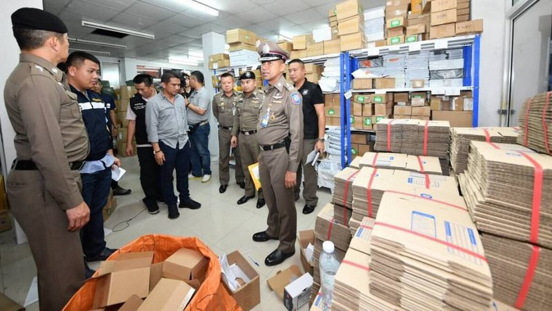 The raid in Pathum Thani saw more than B15 million in fake goods seized. Photo: Immigration Bureau