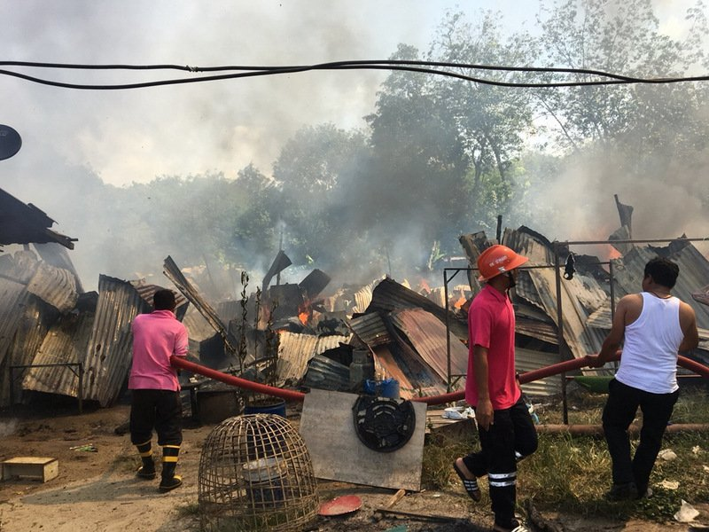 After the first fire at a workers' camp in Kathu was contained, a second fire broke out at a workers' camp in Pa Khlok this morning (Dec 6). Photo: Eakkapop Thongtub