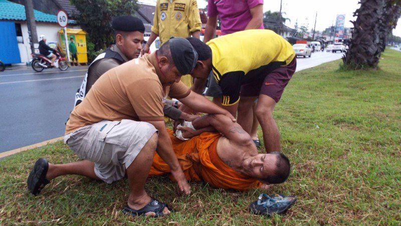 Monk prevented from walking into Phuket traffic
