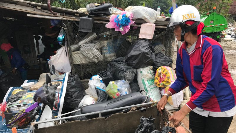 A woman collects recyclable items from Kamala OrBorTor dump. Photo: Kamala OrBorTor