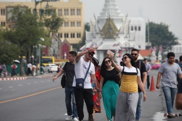 Foreign tourists walk near the Grand Palace and Wat Pho. Photo: Bangkok Post