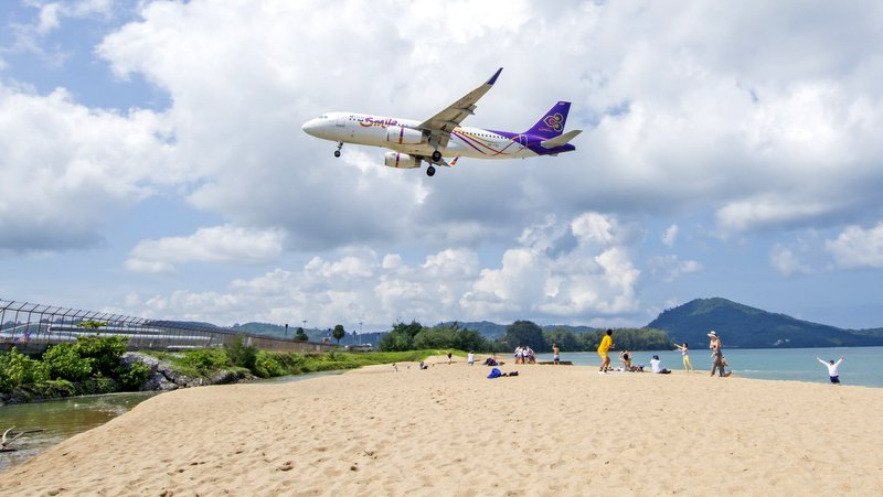 People are being warned to keep clear of the beach area where aircraft flow low while landing at Phuket International airport. Photo: Rattaphol Kerdkaen / Flickr