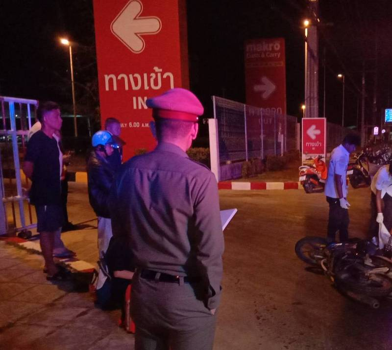 Police and rescue workers at the scene of the accident near Makro in Thalang. Photo: Eakkapop Thongtub