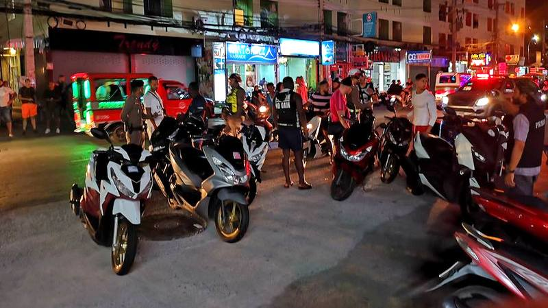 Police set up checkpoints around Malin Plaza in Patong to catch tourists that were disruptive or not following road laws. Photo: Patong Police