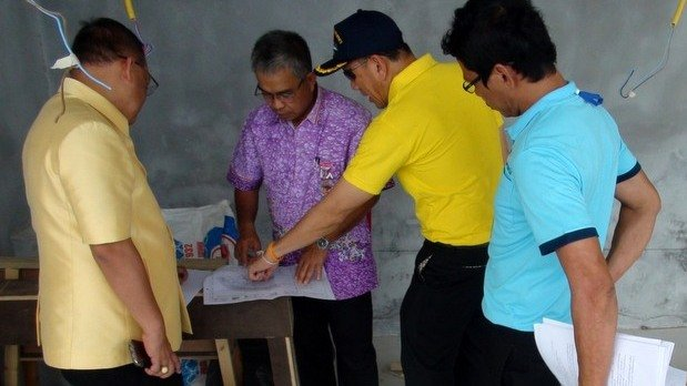 Rawai Mayor Aroon Solos inspects the plans at the luxury villa construction site last month. Photo: Rawai Municipality