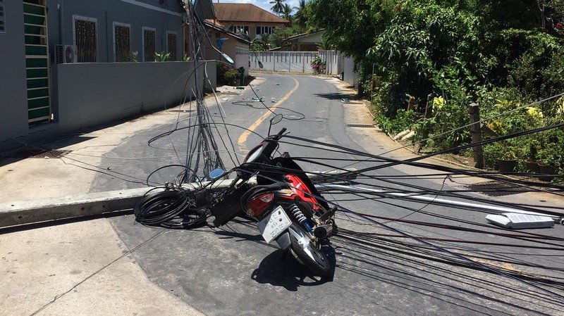 The truck took down seven power poles causing a blackout in the area and injuring a motorcyclist. Photo: PEA Chalong