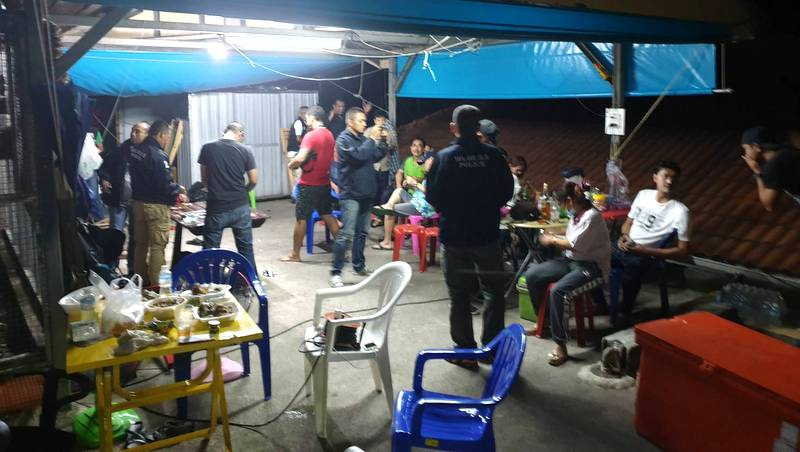 Patong police net 13 suspects during Hi-Lo gambling raid