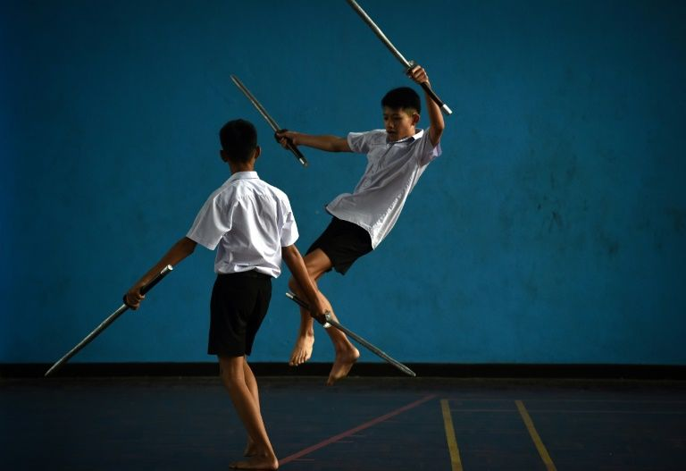 Practitioners now duel with mock weapons in contests or for entertainment. Photo: AFP