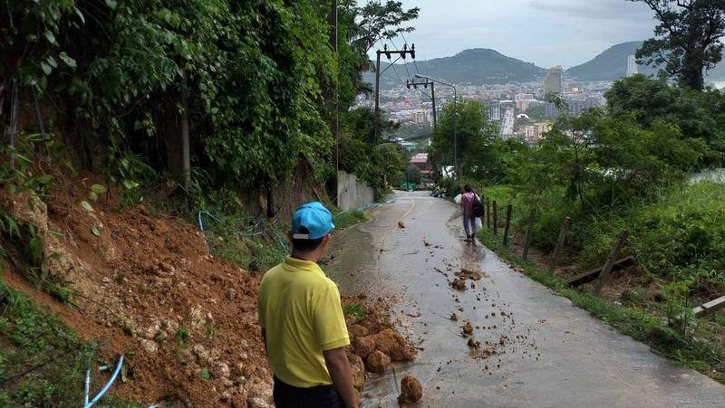Workers attend to a landslip in the hills behind Kalim, north of Patong, yesterday (July 18). Photo: DDPM-Patong