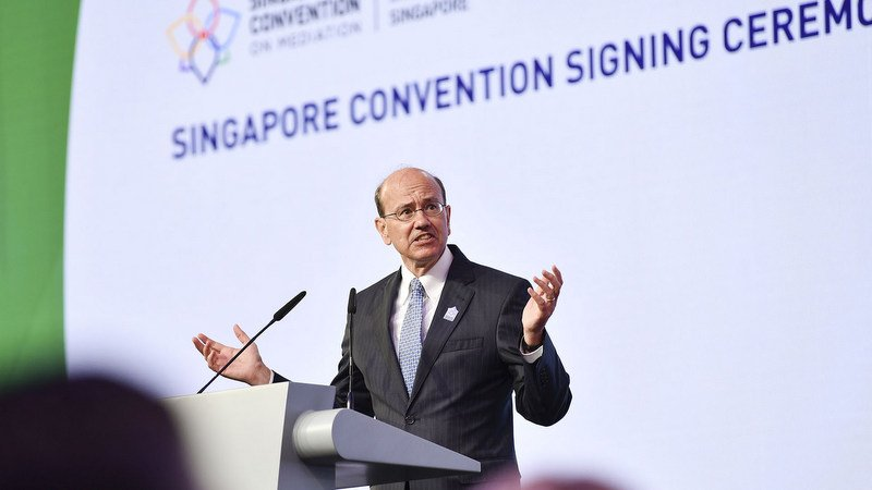 United Nations Assistant Secretary-General for Legal Affairs Stephen Mathias welcomes a guest speaker at the Signing Convention in Singapore last month. Photo: SingaporeConvention.com