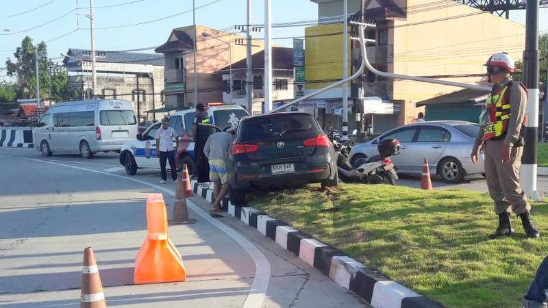 The force of the impact broke the overhanging streetlamp from the post, sending it plunging to the ground, landing on the roof of the BMW below.. Photo: Thalang Police