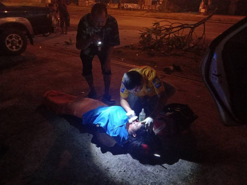 Netchanok Detaran, 42, was lying on the road near the car. She was conscious and responsive, but had suffered serious head injuries. Photo: Eakkapop Thongtub