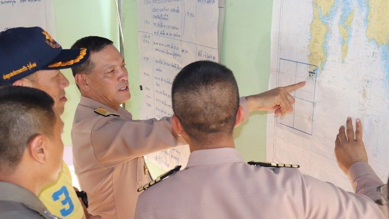 Rear Admiral Cherngchaiyot Atsuwee, Deputy Commander of the Royal Thai Navy Third Area Command, points to the search area on a chart at the search headquarters set up at Yanui Beach. Photo: Royal Thai Navy