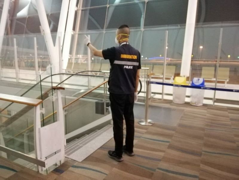 Health Control Division officials check arrivals on direct flights from Wuhan on landing at Phuket International Airport. Photo: Phuket Airport Health Control Division