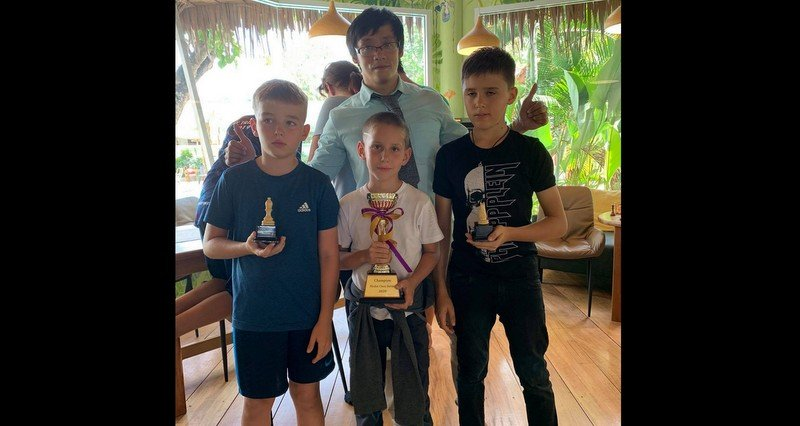 Tournament organiser Bobby Tsang with the Top 3: (L-R) third placed Artem, winner Tye, runner-up Andrian. Photo: Southside Knights Chess Club