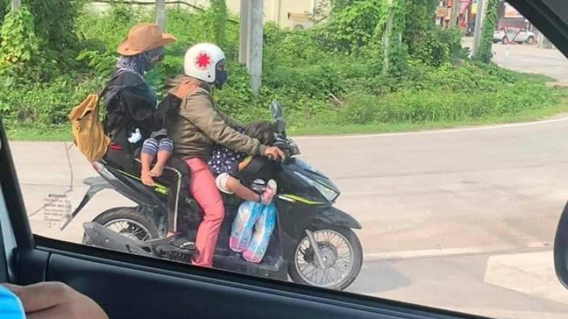 The officers saw the family of five on the one motorbike in Krabi on Friday (May 1). Photo: Knights Border / Facebook