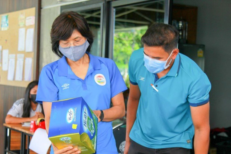 Officials check milk powder to be handed out in Patong. Photo: Patong Municipality