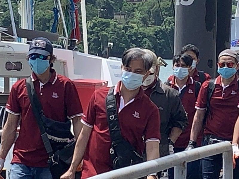 The 13 Thai crewmen came ashore Phuket yesterday (June 10). Photo: Eakkapop Thongtub
