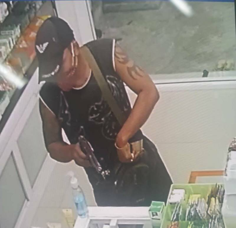 Aung Chun Thar committing the robbery was caught on CCTV. Image: Chalong Police