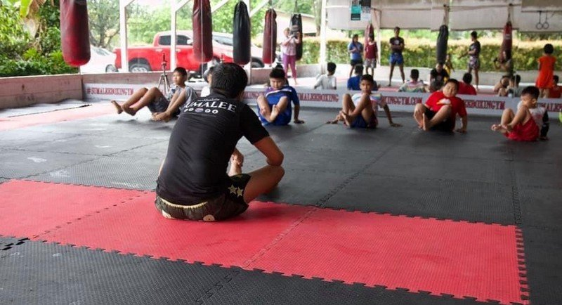The Muay Thai team teach the children. Photo: Rhian Miller