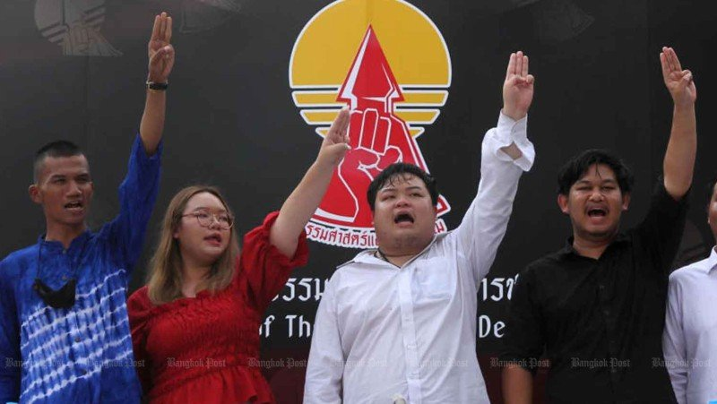Students leaders flash the three-fingers salute against dictatorship during a media conference on Wednesday at Thammasat University announcing a major anti-government rally on Tha Prachan campus. Photo: Wichan Charoenkiatpakul / Bangkok Post