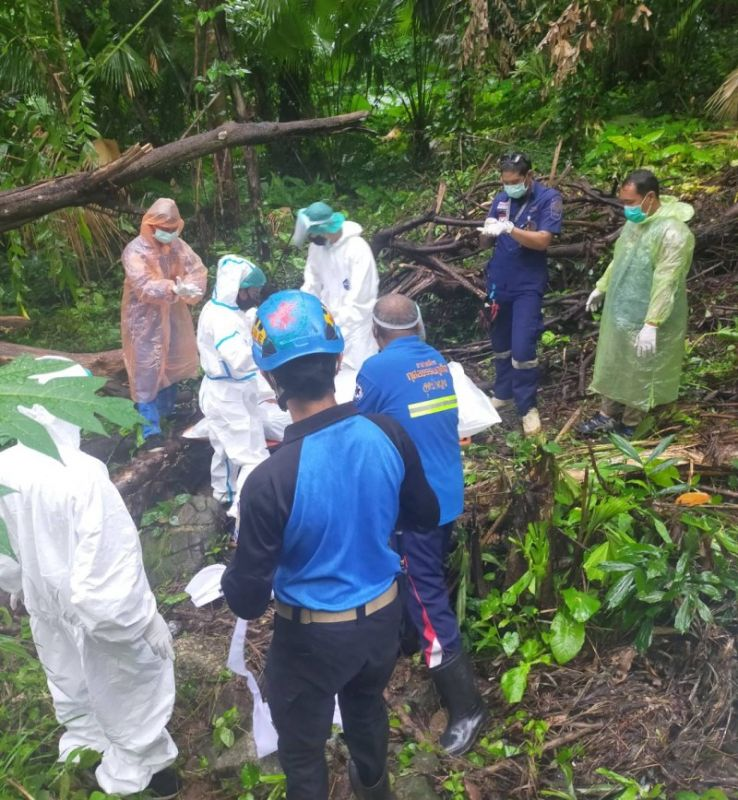 Rescue workers recover the body of Mr Seri, 79. Photo: Patong Police