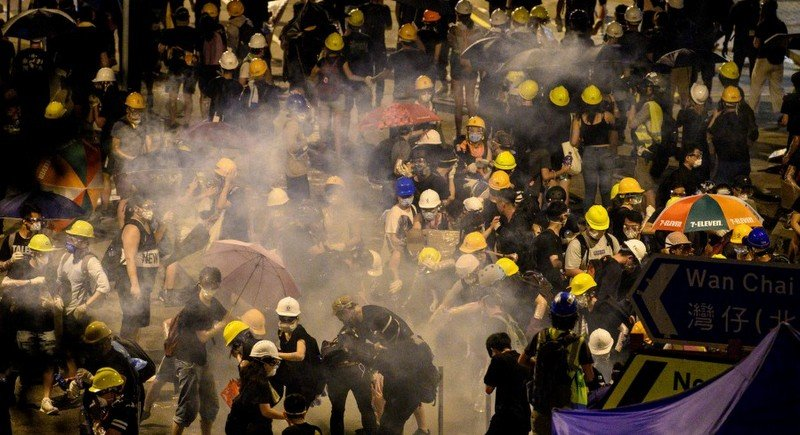 Police fire tear gas at protesters near the government headquarters in Hong Kong on July 2. Photo: AFP.