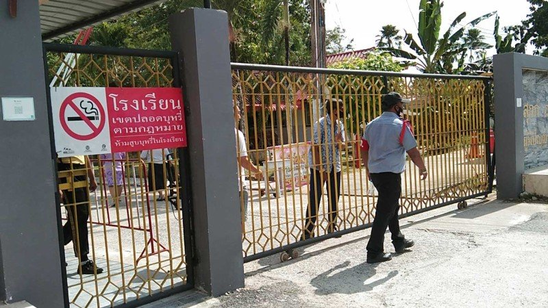 The gates were firmly shut on Friday at the school in Thepha district of Songkhla where the director faces charges of raping a student and carrying a gun during morning assembly. Photo: Assawin Pakkawan / Bangkok Post
