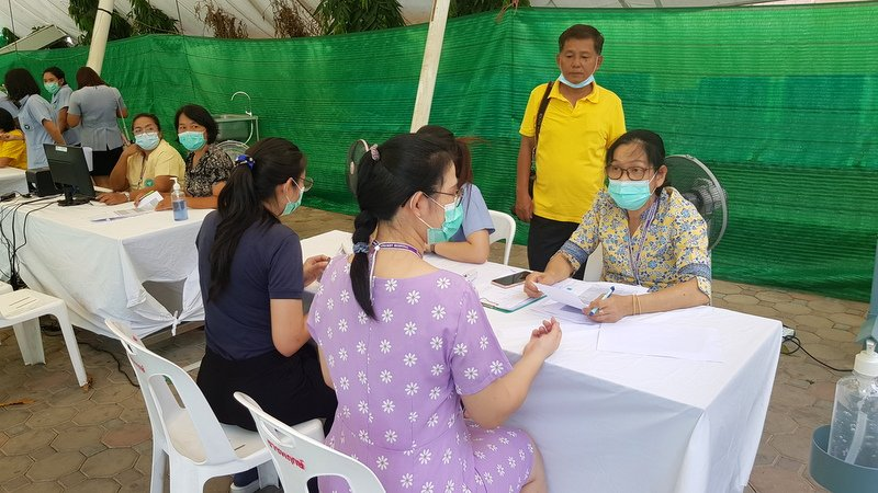Medical staff register to receive the vaccine. A medical staffer receives her first Sinovac COVID-19 vaccination at Vachira Phuket Hospital today (Mar 1). Photo: Kiattikul Chumanee