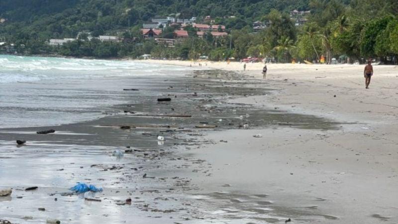 Oil spill tar balls wash ashore at Patong, Nai Yang