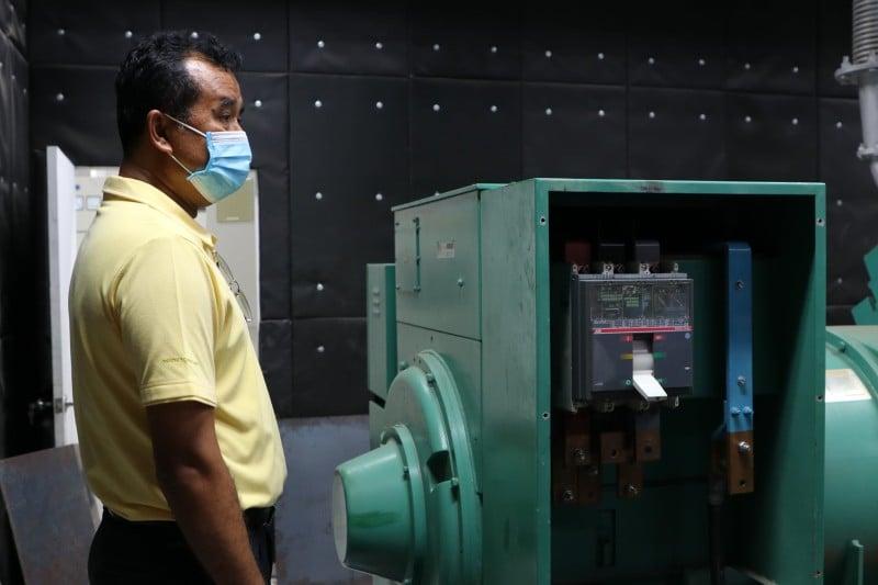 Phuket Highways Office Chief Mr Samak inspects the power control room. Photo: PR Phuket
