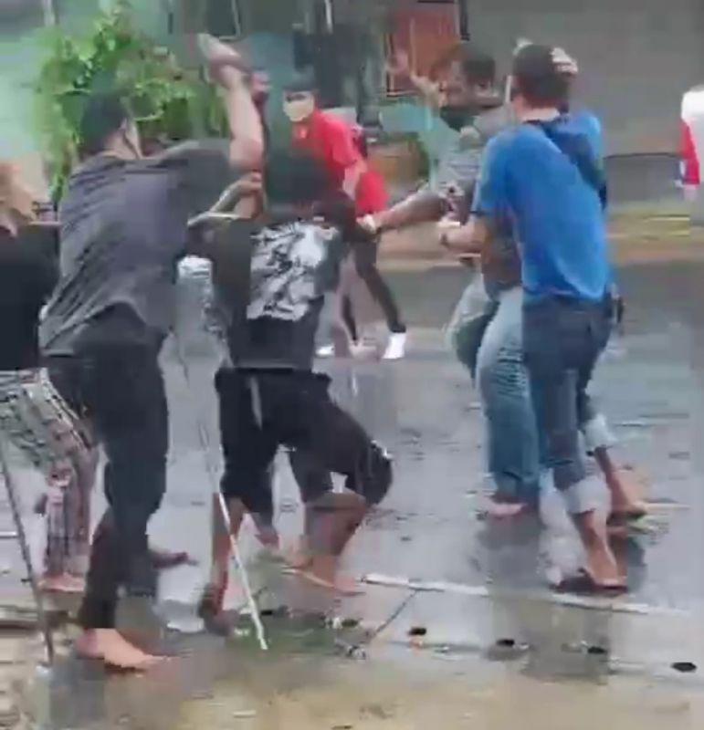The argument erupted into a brawl, which spilled out onto the street. Screenshot: Supplied