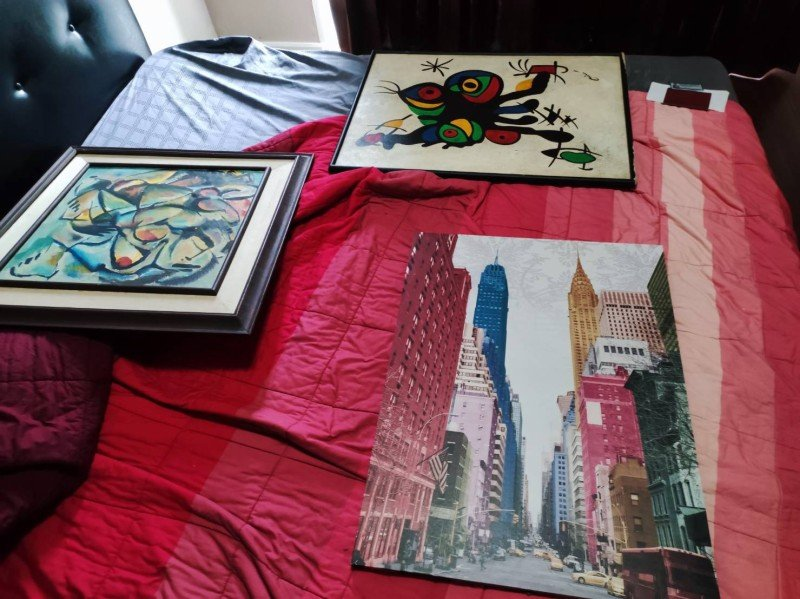 Some of the paintings seized in making the arrests today (Sept 8). Photo: Phuket Immigration