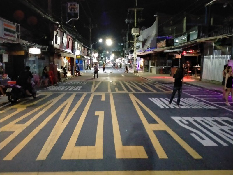 Bars along Bangla Rd in Patong, pictured here last night (Sept 13), have re-opened as 'restaurants'. Photo: The Phuket News